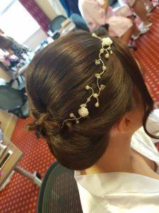 Bride wearing handcrafted hair vine